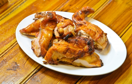 Grilled chicken on plate Stock Photo