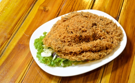 Thai style crispy fish salad traditional cuisine photo