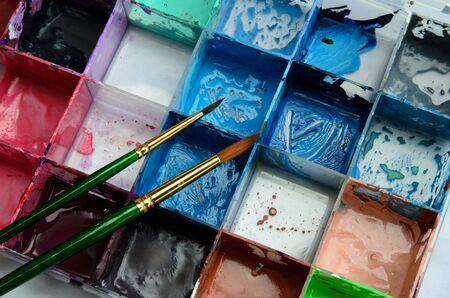 water-color, brush and palette Stock Photo