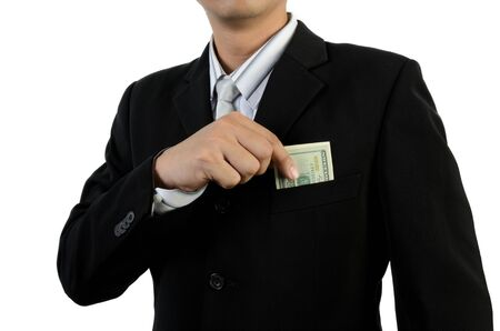 Business man putting money into pocket photo