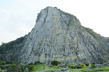 Carved buddha image on the cliff at Khao Chee Jan,Pattaya, Chonburi Thailand photo