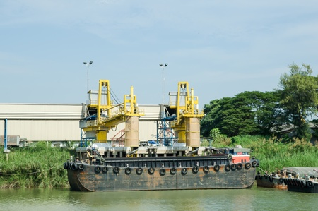 ship and port with loading sacks rice   photo