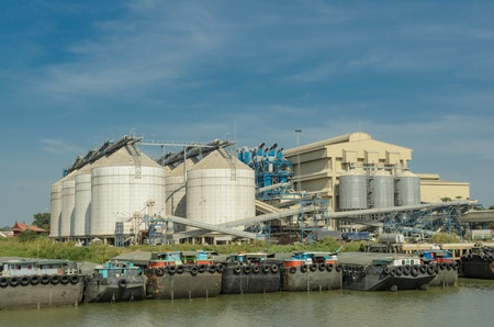 metal silos agriculture granary and ship port photo