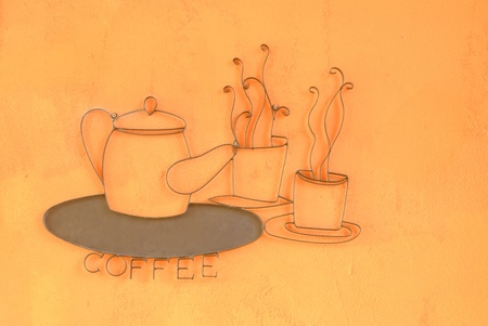 Curved steel Kettle and coffee cup on wall photo