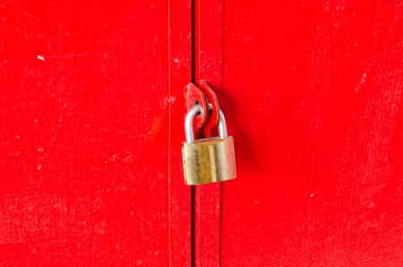 padlock on a red wooden door photo