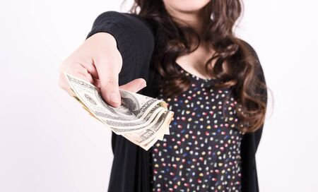 Young woman hand holding one dollar photo