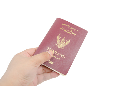 customs official: Thailand Passport and hand on white background