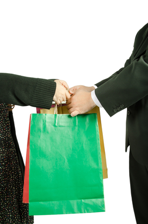 reach customers: Businessman gives a bag  young woman Stock Photo