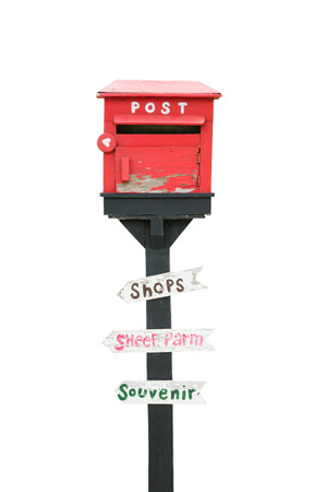 postes: post box and wood sign