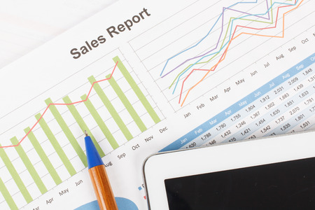 sales growth: sheet of  sales report with pen,and tablet Stock Photo