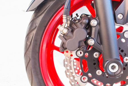 Closeup  caliper of a motorcycles front  wheel