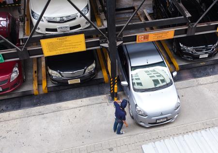 parking facilities: BANKOK THAILAND-MAY 20: Cars park in Automatic parking system in bangkok city on 20 may 2015. Cars park in Automatic parking system in bangkok city thailand.