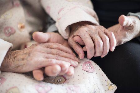 older people shaking hands at home