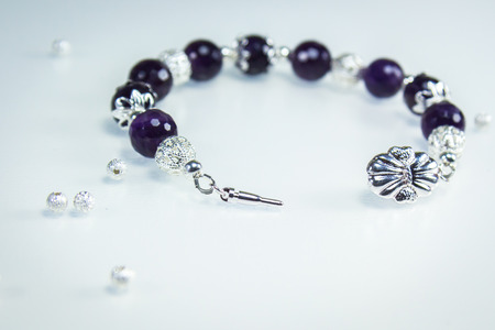 silver plated: Bracelet with Amethyst beads and silver plated filigre beads Stock Photo