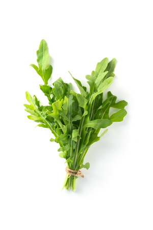 Bunch fresh arugula isolated on a white background