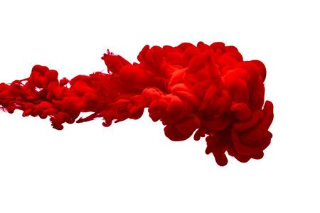 Goccia di inchiostro rosso in acqua, isolata su un bianco. Sfondo astratto. Archivio Fotografico