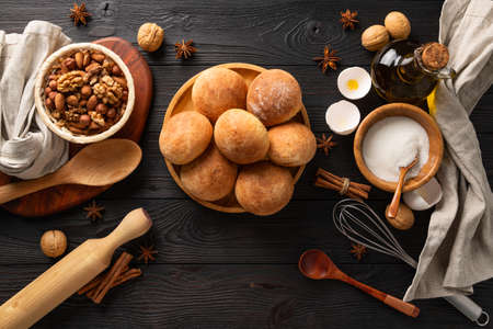 cooked fresh buns for breakfast on wooden background among the ingredients, flat lay