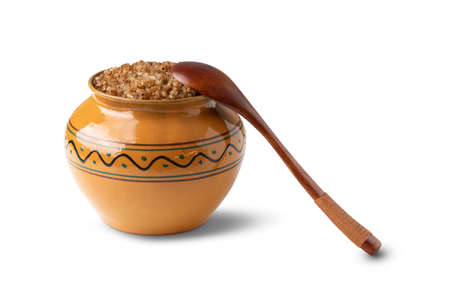cooked buckwheat porridge in a clay pot in the oven isolated on white background Banco de Imagens