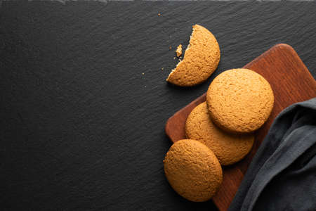 fresh oatmeal cookies on a stone background, top view Banco de Imagens