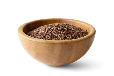 flax seeds in a wooden bowl on a isolated on a white background Banco de Imagens