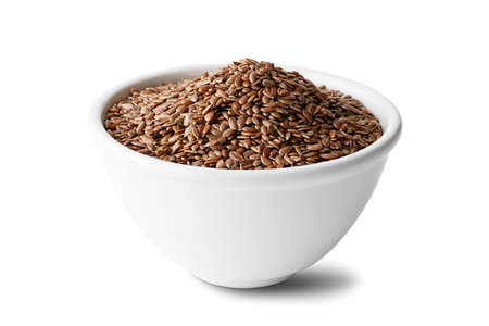 flax seeds in a ceramic bowl on a isolated on a white background Banco de Imagens