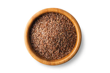 flax seeds in a wooden bowl on a isolated on a white background, top view