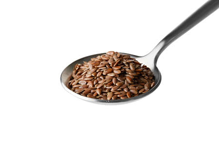 flax seeds in iron spoon isolated on white background Banco de Imagens