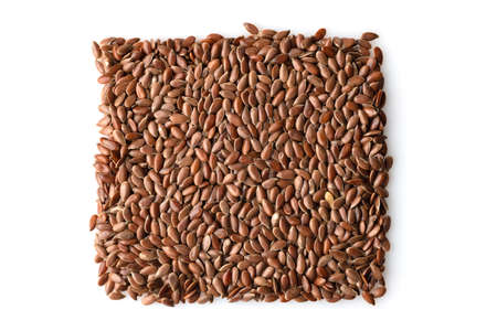 flax seeds isolated on a white background, top view Banco de Imagens
