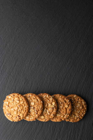 oatmeal cookies with grains on a stone background Banco de Imagens