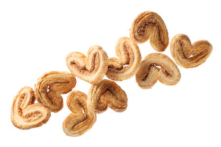 falling crunchy cookies with sugar and cinnamon, isolated on white background Banco de Imagens