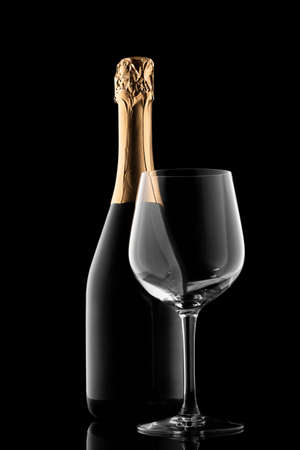 Champagne bottle silhouette and glass isolated on black background