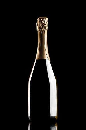 silhouette of closed bottle of champagne without label isolated on black background