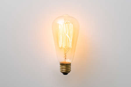 vintage light bulb glows without wires on white background Banco de Imagens