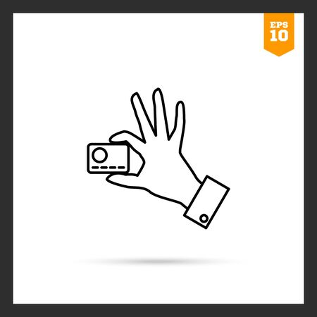 holding credit card: Icon of mans hand holding credit card with two fingers