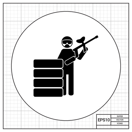 survival: Paintball player in mask with gun behind stacked tires. Survival, team, extreme. Paintball concept. Can be used for topics like paintball, sport, games.
