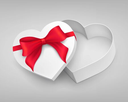 red gift box: Heart-shaped gift box with red tied knot Stock Photo