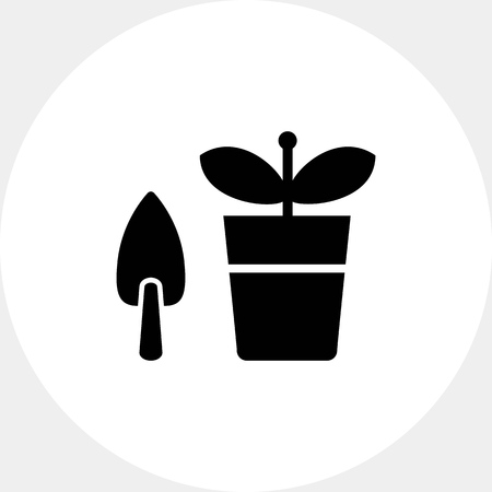potted plant: Potted plant with shovel