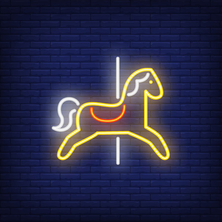 Carousel horse neon sign. Yellow animal seat on dark blue brick wall. Night bright advertisement. Vector illustration in neon style for amusement park and leisure