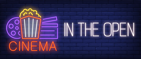 Cinema in the open neon sign. Popcorn box, film reel, clapper on brick wall background. Vector illustration in neon style for movie outdoors