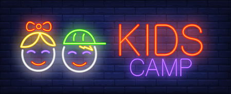 Kids camp neon sign. Glowing neon inscription with baby faces of girl and boy on blue brick background. Can be used for child garden, kids camp, kids area