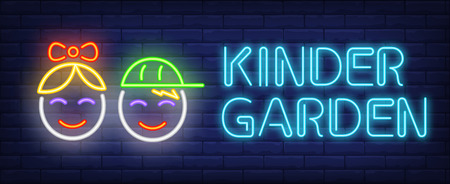 Kinder garden neon sign. Glowing neon inscription with faces of girl and boy on dark blue brick background. Can be used for kids area, kinder garden, advertisement
