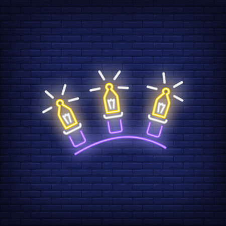 Three garland lights neon sign. Glowing lamps on dark blue brick background. Can be used for home decoration, festive, Christmas time