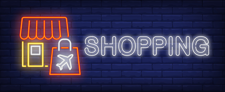 Shopping neon sign. Glowing inscription with shop and paper bag on brick wall background. Can be used for shopping, duty free, airport