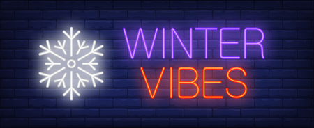 Winter vibes neon text with snowflake. Christmas advertisement design. Night bright neon sign, colorful billboard, light banner. Vector illustration in neon style.