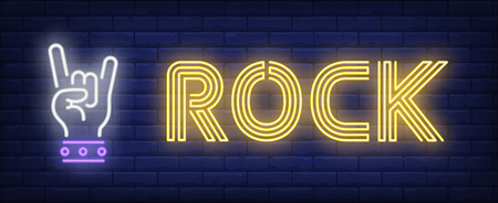 Rock neon sign. Hand with two fingers in devil horns gesture on brick wall background. Vector illustration in neon style for banners, billboards, concert ads