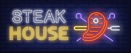 Steak house neon text, beef steak with crossed skewers and fork. Meat cooking and barbeque design. Night bright neon sign, colorful billboard, light banner. Vector illustration in neon style. Vektorové ilustrace