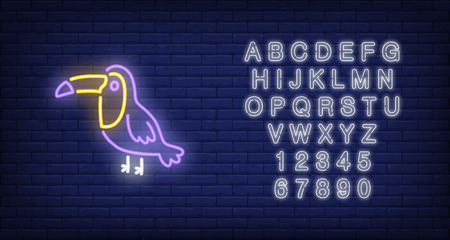 Toucan neon sign. Tropical bird on dark brick wall background. Night bright advertisement. Vector illustration in neon style for pet shop or zoo