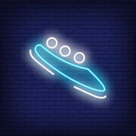 Blue bobsleigh neon sign. Glowing bob with sport team on dark blue brick background. Standard-Bild
