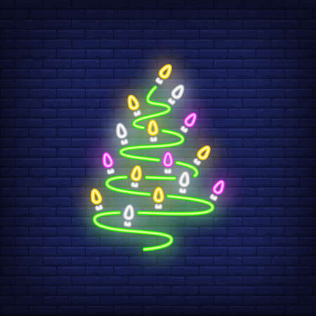 Festive garland neon sign. Glowing multicolored lamps on dark blue brick background. Can be used for winter, christmas time, festive Reklamní fotografie