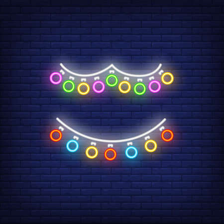 Multicolored retro garland neon sign. Glowing multicolored lamps on dark blue brick background. Can be used for home decoration, festive, Christmas time
